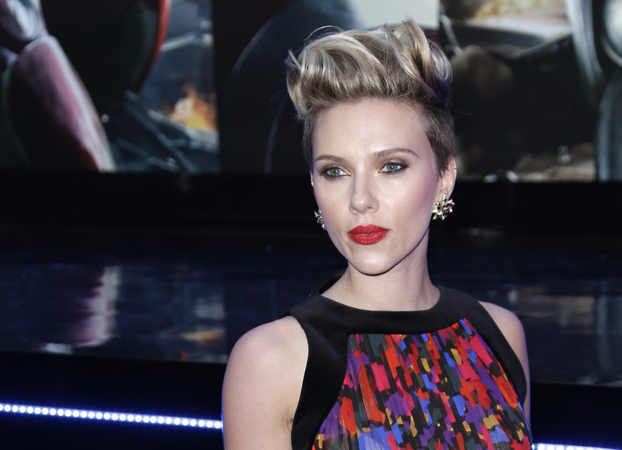 FILE - In this April 21, 2015, file photo, Scarlett Johansson poses for photographers upon arrival at the premiere for the film 'The Avengers Age of Ultron' in London. Box Office Mojo has crowned Johansson as Hollywood's highest grossing actress on a list updated June 29, 2016.(Photo by Joel Ryan/Invision/AP, File)