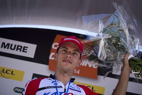 Slovenian Simon Spilak celebrates on the podium after winning the fifth stage (Sisteron - La Mure) of the 66th  Dauphine Criterium cycling race on June 12, 2014 at La Mure. AFP PHOTO / LIONEL BONAVENTURE