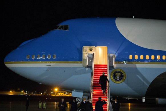 President Donald Trump walks up the stairs of Air Force One before departure at Andrews Air Force Base, Md., Monday, Jan. 20, 2020, en route to Davos, Switzerland, to attend the World Economic Forum. ( AP Photo/Jose Luis Magana)