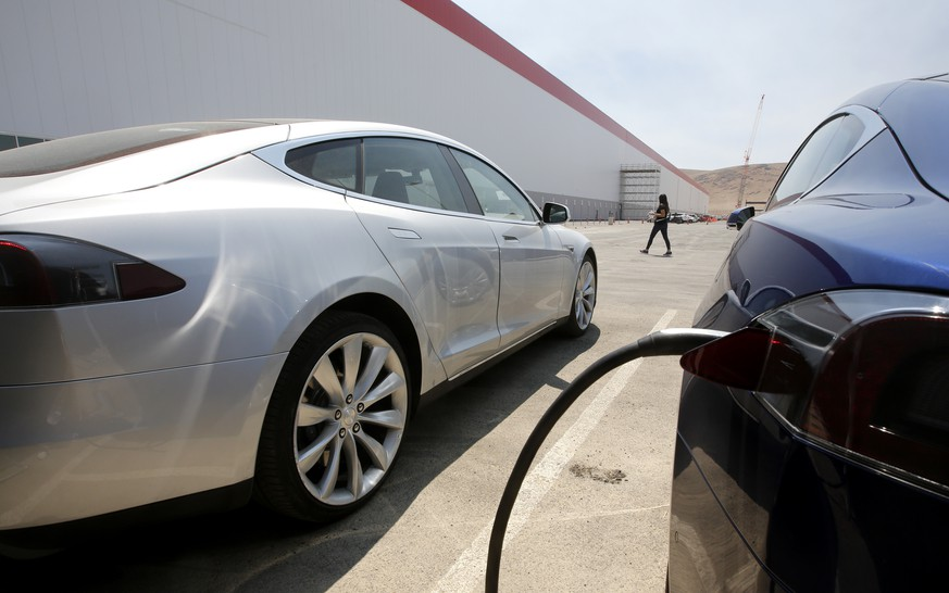 Tesla Motors model S cars are charged at the new Tesla Gigafactory, Tuesday, July 26, 2016, in Sparks, Nev. The Gigafactory is Tesla Motors' biggest bet yet: A massive, $5 billion factory in the Nevada desert that could almost double the world's production of lithium-ion batteries by 2018. (AP Photo/Rich Pedroncelli)