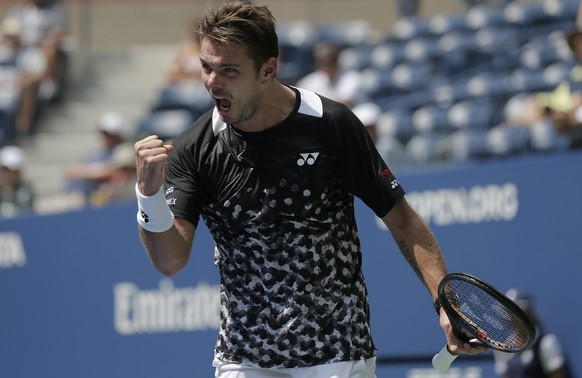 Stan Wawrinka, of Switzerland, reacts during his match against Grigor Dimitrov, of Bulgaria, during the first round of the U.S. Open tennis tournament, Monday, Aug. 27, 2018, in New York. (AP Photo/Seth Wenig)