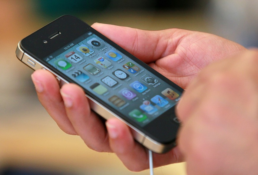 SAN FRANCISCO, CA - OCTOBER 14:  An Apple Store customer looks at the new Apple iPhone 4Gs on October 14, 2011 in San Francisco, United States.  The new iPhone 4Gs went on sale today and features a faster dual-core A5 chip, an 8MP camera that shoots 1080p HD video, and a voice assistant program.  (Photo by Justin Sullivan/Getty Images)