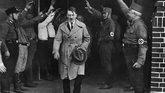 FILE - In this Dec. 5, 1931 file photo Adolf Hitler, leader of the National Socialists, leaves the party's Munich, Germany headquarters. On Friday, June 12, 2020, The Associated Press reported on stories circulating online incorrectly asserting that Hitler defunded the police and installed his own enforcers. Gavriel D. Rosenfeld, a historian and history professor at Fairfield University says,