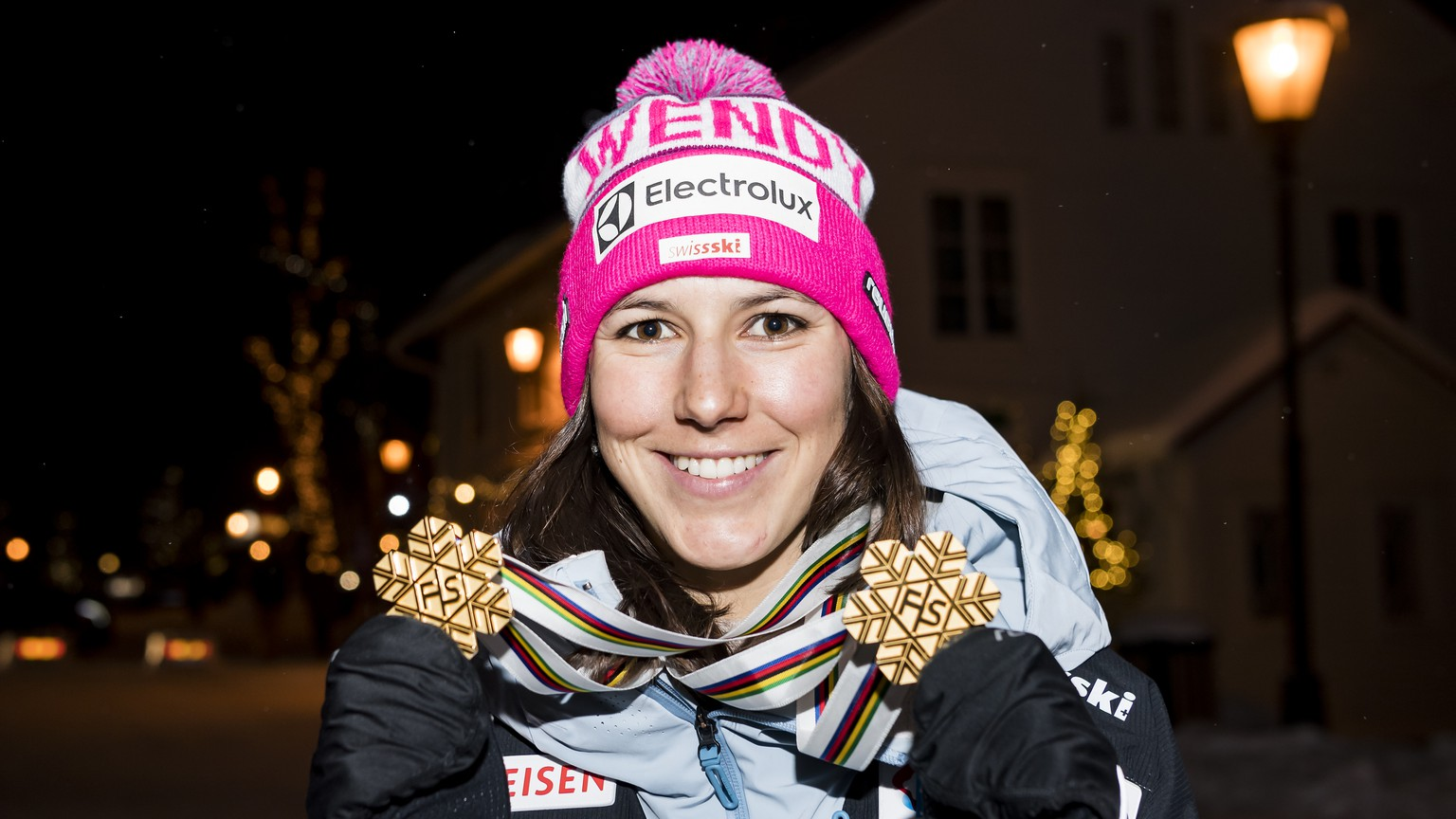 Wendy Holdener of Switzerland poses with the gold medal for the Team Event and the gold medal for the Alpine Combined after the Alpine Team Event at the 2019 FIS Alpine Skiing World Championships in Are, Sweden Tuesday, February 12, 2019. (KEYSTONE/Jean-Christophe Bott)