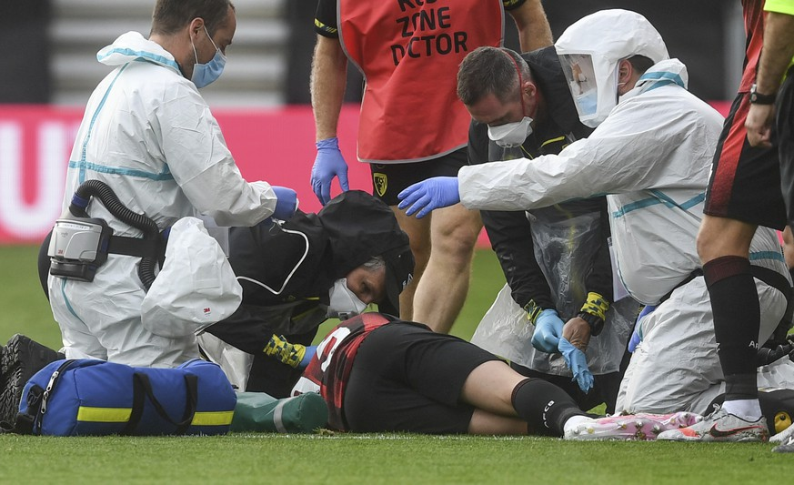 Bournemouth's Adam Smith receives medical attention during the English Premier League soccer match between Bournemouth and Tottenham at the Vitality Stadium in Bournemouth, England, Thursday, July 9, 2020. (Neill Hall/Pool via AP)