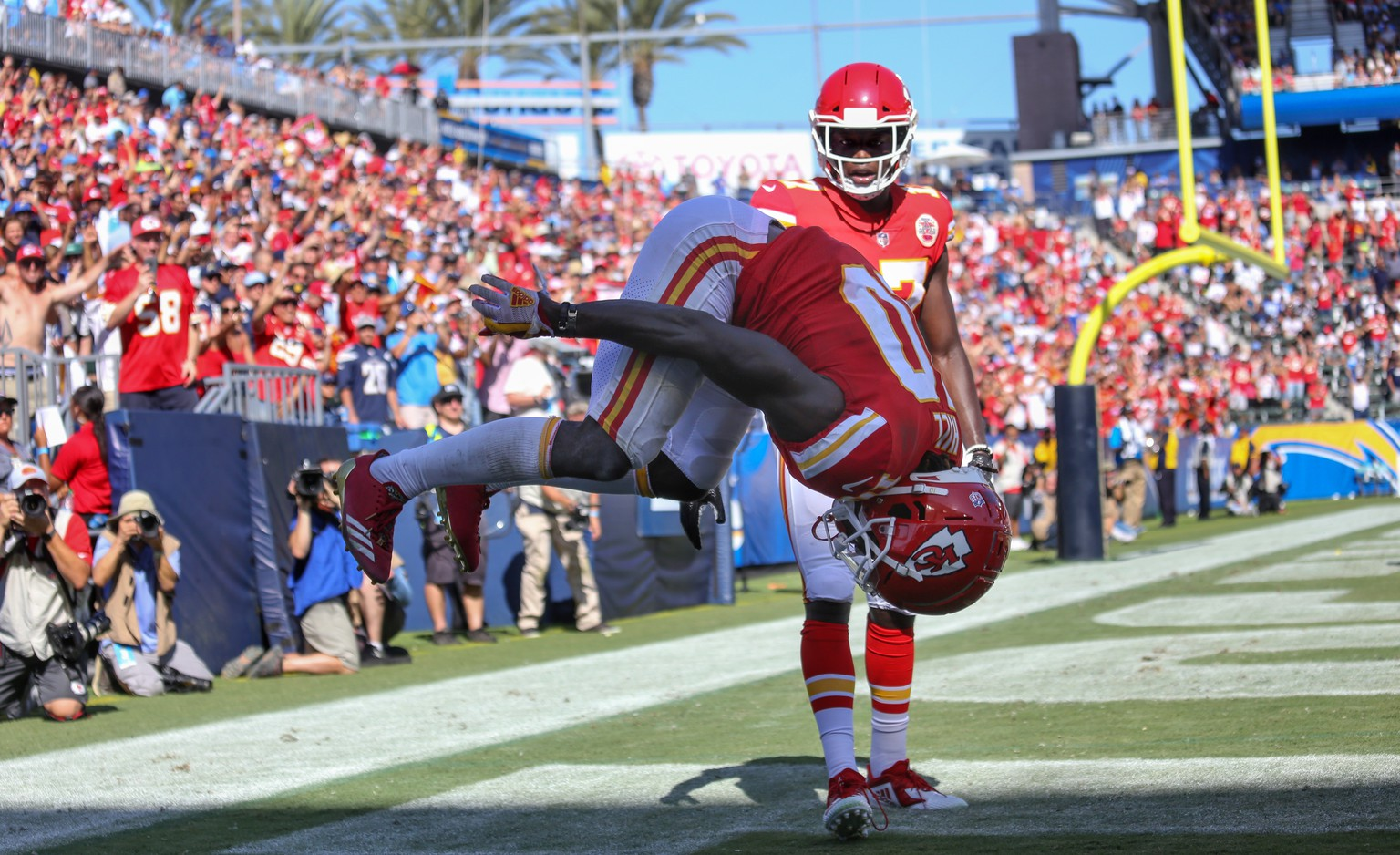 epa07009419 Kansas City Chiefs wide receiver Tyreek Hill (L) does a back flip celebration of his touchdown catch as teammate Chris Conley looks on against the Los Angeles Chargers during the second half of their game at the Stubhub Center in Carson, California, USA 09 September 2018.  EPA/EUGENE GARCIA