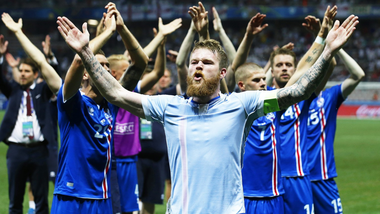 epa05395426 Aron Gunnarsson (front) of Iceland and his teammates celebrate after the UEFA EURO 2016 round of 16 match between England and Iceland at Stade de Nice in Nice, France, 27 June 2016. Iceland won 2-1.