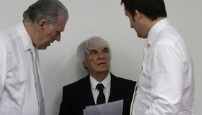 Formula One boss Bernie Ecclestone prepares for his trial  framed by his  his lawyers  Sven Thomas, left, and Norbert Scharf, right, in the regional court in Munich, southern Germany, Tuesday, July 29, 2014. Ecclestone is charged with bribery and incitement to breach of trust