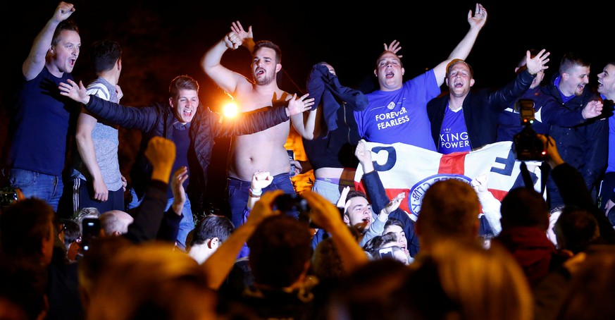 Leicester City fans celebrate their team winning the English Premier League outside the home of player Jamie Vardy in Melton Mowbray, Britain May 2, 2016. REUTERS/Darren Staples