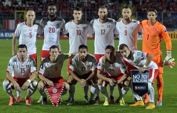 Switzerland national soccer team poses prior to the start of the Euro 2016, Group E qualifying soccer match between San Marino and Switzerland, at the Serravalle Stadium, San Marino, Tuesday, Oct. 14, 2014. (AP Photo/Marco Vasini)