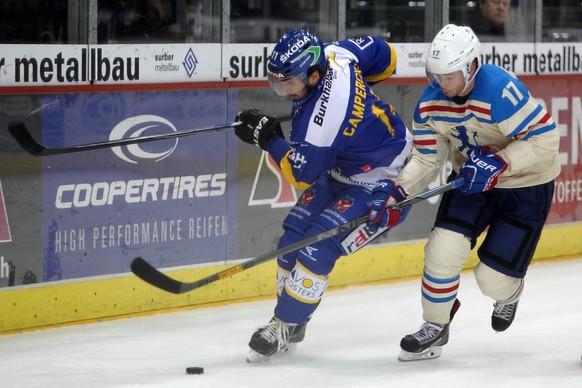 12.10.2014; Zuerich; Eishockey NLA - ZSC Lions - HC Davos; Luca Camperchioli (L, Davos) gegen Ryan Shannon (R, ZSC) (Francoise Ducrey/freshfocus)