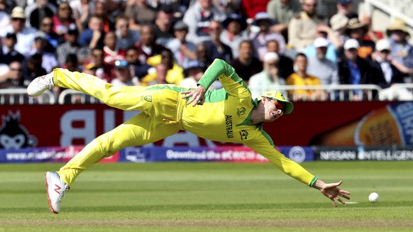 Australia's Steve Smith dives to stop the ball during the Cricket World Cup match between Australia and West Indies at Trent Bridge in Nottingham, Thursday, June 6, 2019. (AP Photo/Rui Vieira)