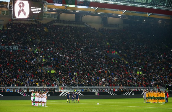 KAISERSLAUTERN, GERMANY - MARCH 25:  Players, officials and fans remember the victims of the recent Germanwings air crash prior to the international friendly match between Germany and Australia at Fritz-Walter-Stadion on March 25, 2015 in Kaiserslautern, Germany. The Germanwings flight 4U9525 crashed in the French Alps on March 24, 2015 at Seyne, France. The Airbus A320 airliner travelling from Barcelona to Dusseldorf went down with 150 people onboard.  (Photo by Alexander Hassenstein/Bongarts/Getty Images)