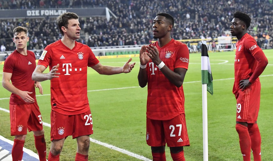Bayern's Joshua Kimmich, Thomas Mueller, David Alaba and Alphonso Davies, from left, stand on the pitch disappointed after losing the German Bundesliga soccer match between Borussia Moenchengladbach and Bayern Munich at the Borussia Park in Moenchengladbach, Germany, Saturday, Dec. 7, 2019. Moenchengladbach defeated Bayern with 2-1. Moenchengladbach's Ramy Bensebaini, 3rd from right, scored twice. (AP Photo/Martin Meissner)