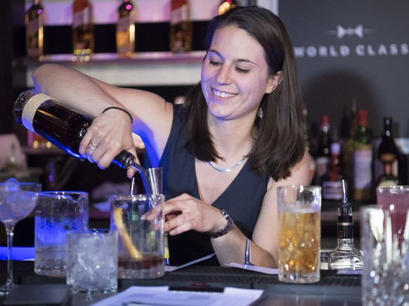 Swiss bartender and winner of the Swiss World Class Bartender 2016 Championship Sophie Larrouture from Bar des Bergues - Hotel Four Seasons in Geneva makes cocktails during the competition at the MAD in Lausanne, late Monday evening, May 23, 2016. 12 Swiss bartender compete to win a place for the upcomming World Championship Class Bartender of the Year competition next September in Miami, USA, an annual celebration of the art and craft of bartending. (KEYSTONE/Laurent Gillieron)