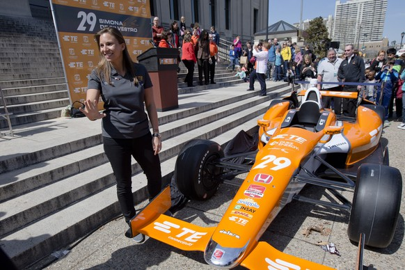 Driver Simona de Silvestro poses for photographs during a news conference Thursday, April 2, 2015, at the The Franklin Institute in Philadelphia. Michael Andretti announced that the Swiss-born de Silvestro will drive the No. 29 TE Connectivity Honda in the  Indianapolis 500 auto race. (AP Photo/Matt Rourke)