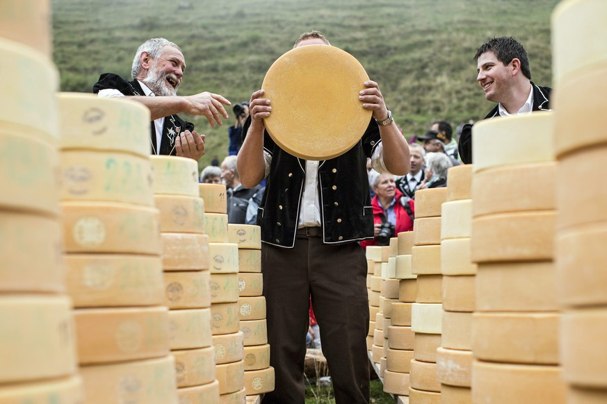 epa04936862 epa04936860 Dairy farmers attend traditional Chaesteilet (lit.: sharing the cheese) in Justistal, Switzerland, 18 September 2015. The local farmers whose cows have spend the summer on the pastures of the valley share the cheese in relation to the milk yield of their cows. Thousands of people attend the tradition of Chaeseteilet.  EPA/ALEXANDRA WEY FINLAND OUT  EPA/ALEXANDRA WEY FINLAND OUT