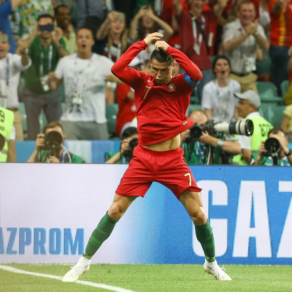 epa06811618 Cristiano Ronaldo of Portugal celebrates after scoring against Spain during the FIFA World Cup 2018 group A preliminary round soccer match between Portugal and Spain at the Fisht Stadium, in Sochi, Russia, 15 June 2018. (RESTRICTIONS APPLY: Editorial Use Only, not used in association with any commercial entity - Images must not be used in any form of alert service or push service of any kind including via mobile alert services, downloads to mobile devices or MMS messaging - Images must appear as still images and must not emulate match action video footage - No alteration is made to, and no text or image is superimposed over, any published image which: (a) intentionally obscures or removes a sponsor identification image; or (b) adds or overlays the commercial identification of any third party which is not officially associated with the FIFA World Cup)  EPA/PAULO NOVAIS   EDITORIAL USE ONLY