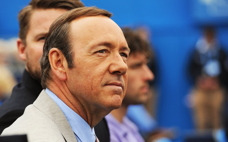 epa06297780 (FILE) - US actor Kevin Spacey watches a match during the Aegon Tennis Championships at the Queen's Club in London, Britain, 12 June 2013 (reissued 30 October 2017). In a statement posted on Twitter on 29 October 2017, Spacey has apologized to US actor Anthony Rapp, who had accused Spacey of acting sexually inappropriate towards him when he was 14. In the same post, Spacey said he chose 'now to live as a gay man'.  EPA/ANDY RAIN
