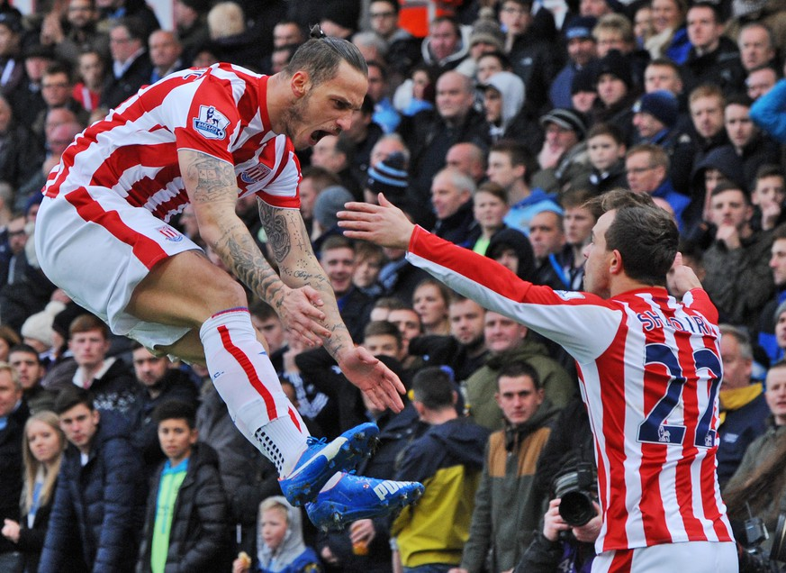 Stoke's Marko Arnautovic, left, celebrates with Stoke's Xherdan Shaqiri after scoring against Manchester City during the English Premier League soccer match between Stoke City and Manchester City at the Britannia Stadium, Stoke on Trent, England, Saturday, Dec. 5, 2015. (AP Photo/Rui Vieira)