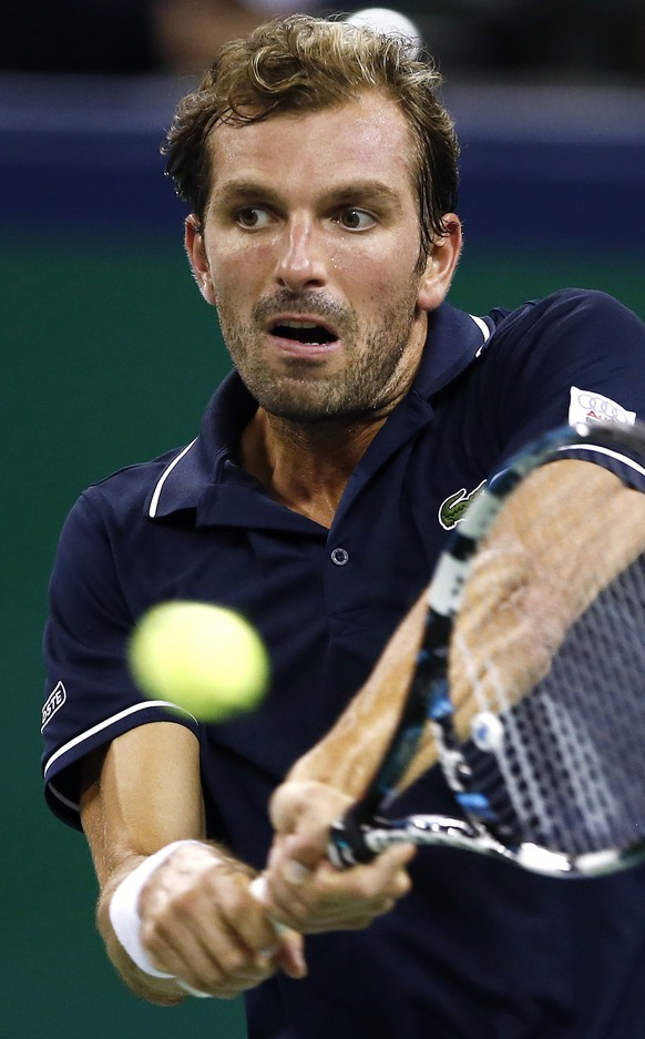 Julien Benneteau of France returns a shot during his men's singles match against Roger Federer of Switzerland at the Shanghai Masters tennis tournament in Shanghai October 10, 2014. REUTERS/Aly Song (CHINA - Tags: SPORT TENNIS)
