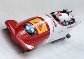 Switzerland's Rico Peter and his team compete during the four-man bobsled competition at the Bob and Skeleton World Championships in Winterberg, Germany, Sunday, March 8, 2015. (AP Photo/Jens Meyer)