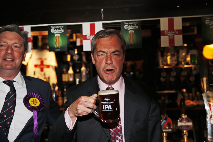 FILE - In this Friday, May 23, 2014 file photo, Nigel Farage, leader of Britain's United Kingdom Independence Party (UKIP) enjoys a pint of beer in South Benfleet, England. The UK Independence Party says the resignation of Nigel Farage as party leader has been rejected and he remains in the post. The announcement Monday, May 11, 2015, came three days after Farage said he was stepping down following his failure to win a seat in Parliament.  (AP Photo/Lefteris Pitarakis, File)