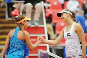 NUREMBERG, GERMANY - MAY 18:  Mona Barthel of Germany shakes hands after defeating Belinda Bencic of Switzerland during Day 2 of the Nuernberger Versicherungscup on May 18, 2014 in Nuremberg, Germany.  (Photo by Dennis Grombkowski/Bongarts/Getty Images)