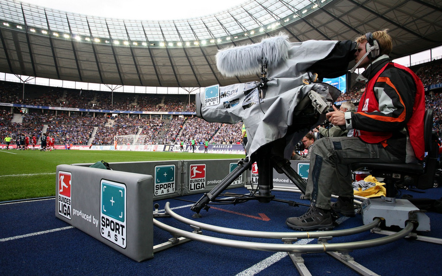 A cameraman is pictured during the German first division Bundesliga soccer match between Hertha BSC Berlin and FC Energie Cottbus in Berlin, Germany, on Saturday, Oct. 6, 2007. (AP Photo/Miguel Villagran) ** NO MOBILE USE UNTIL 2 HOURS AFTER THE MATCH, WEBSITE USERS ARE OBLIGED TO COMPLY WITH DFL-RESTRICTIONS, SEE INSTRUCTIONS FOR DETAILS **