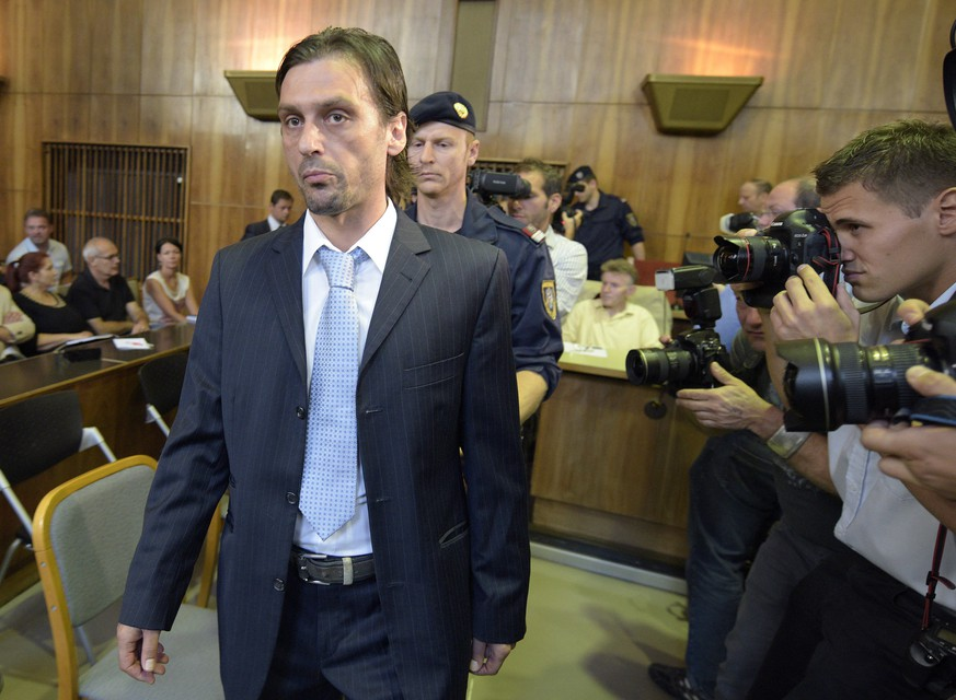 FILE - In this Aug. 8, 2014 file photo former soccer player Sanel Kuljic arrives for the first round of a trial at the main court in Graz, Austria. The court has sentenced former Austria international Kuljic to five years in prison, Friday, Oct. 3, 2014, in a match-fixing case that rocked Austrian football last year. (AP Photo/Hans Punz, File)
