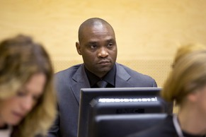 "Germain Katanga, a Congolese National, sits during his trial at the International Criminal Court (ICC) in the Hague on May 23, 2014. The International Criminal Court on Friday sentenced Congolese warlord Germain ""Simba"" Katanga to 12 years in jail for arming an ethnic militia that carried out a ""particularly cruel"" 2003 village massacre.  Katanga, 36, was convicted in March 2014 of war crimes and crimes against humanity including murder and pillaging for his role in the attack on Bogoro village in the volatile eastern Democratic Republic of Congo on February 24, 2003.  