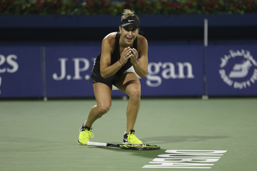 Switzerland's Belinda Bencic celebrates after defeating Czech Republic's Petra Kvitova during their final match of the Dubai Duty Free Tennis Championship in Dubai, United Arab Emirates, Saturday, Feb. 23, 2019. (AP Photo/Kamran Jebreili)