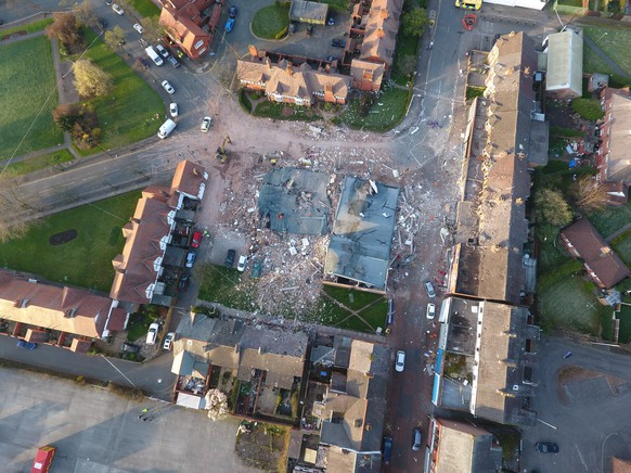 epa05871525 An aerial view 26 March 2017 over the the devastated buildings destroyed late 25 March 2017 by a an explosion in Bebington, Wirral, near Liverpool, Britain. Reports state two people have been seriously injured and 32 others hurt after several buildings collapsed in a suspected gas explosion. Houses shook and windows smashed in the blast - described as sounding like an earthquake - leaving bricks and debris strewn on roads. A number of houses in the area were evacuated and more than 100 people were moved overnight to a nearby church. A dance studio for children, which was unoccupied at the time, was destroyed.  EPA/SWNS.COM UK AND IRELAND OUT