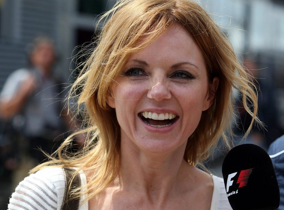 epa03767555 Ex Spice Girl Geri Halliwell in the F1 Paddock prior to the British Formula One Grand Prix at Silverstone race track, Northamptonshire, Britain,  30 June 2013.  EPA/GEOFF CADDICK