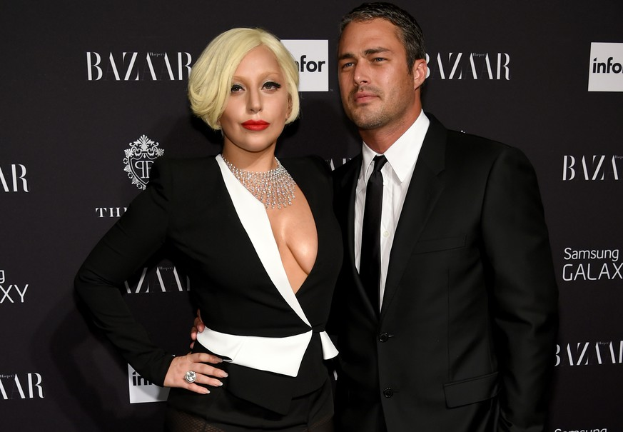 NEW YORK, NY - SEPTEMBER 05:   Lady Gaga and Taylor Kinney attend Samsung GALAXY At Harper's BAZAAR Celebrates Icons By Carine Roitfeld at The Plaza Hotel on September 5, 2014 in New York City.  (Photo by Dimitrios Kambouris/Getty Images for Samsung)