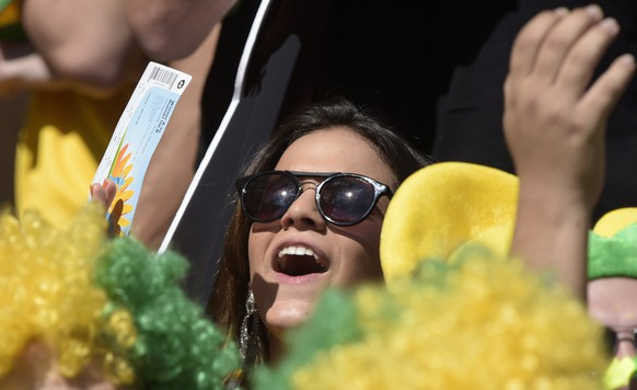 Gabriella Lenzi, the girlfriend of Brazil's forward Neymar, attends the Round of 16 football match between Brazil and Chile at The Mineirao Stadium in Belo Horizonte during the 2014 FIFA World Cup on June 28, 2014. AFP PHOTO / JUAN MABROMATA