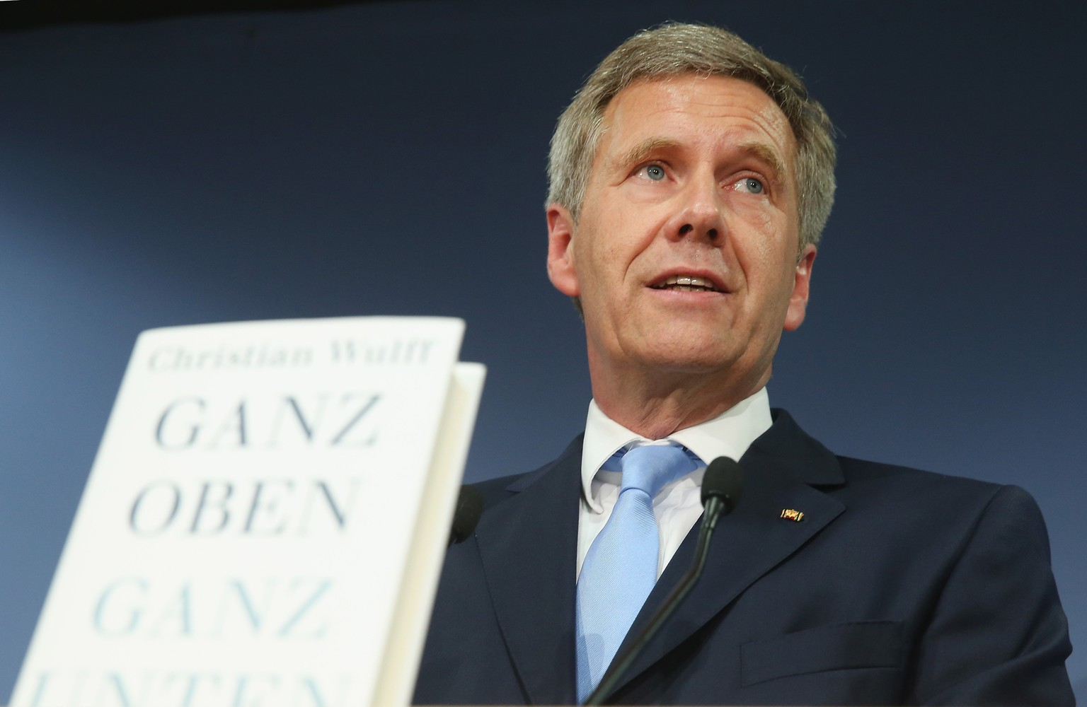 BERLIN, GERMANY - JUNE 10:  Former German President Christian Wulff (R) presents his new book