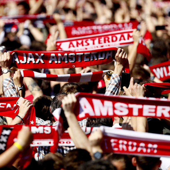 epa07575838 Ajax fans celebrate at the Museumplein the win of the Dutch Eredivisie soccer championship in Amsterdam, The Netherlands, 16 May 2019. Ajax Amsterdam won his 34th national title on 15 May 2019.  EPA/ROBIN VAN LONKHUIJSEN