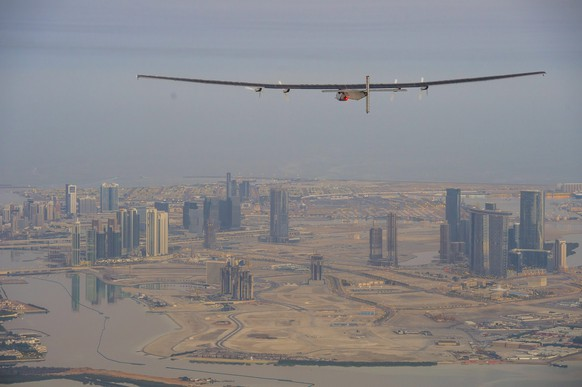 epa04638110 A handout photo made available by the Solar Impulse showing the Solar Impulse 2 during the first test flight in Abu Dhabi, UAE, 26 February 2015. Solar Impulse 2 successfully accomplished the first test flight since the reassembly with the test pilot Markus Scherdel at the controls. Solar Impulse 2, the only solar single-seater airplane able to fly day and night without a drop of fuel, will attempt the First Round-The-World Solar Flight in early March 2015, departing from Abu Dhabi. Swiss founders and pilots, Bertrand Piccard and Andre Borschberg, will take turns flying Solar Impulse 2 over the Arabian Sea, to India, Myanmar, China, then across the Pacific Ocean, to the United States, and over the Atlantic Ocean to Southern Europe or Northern Africa before finishing the journey by returning to the initial departure point.  EPA/JEAN REVILLARD / SOLAR IMPULSE/HAND  HANDOUT EDITORIAL USE ONLY/NO SALES