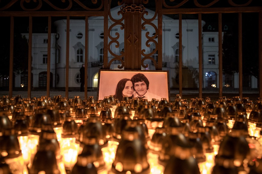 epa07501244 (FILE) - Candles are placed during a march in memory of murdered Slovak journalist Jan Kuciak and his fiancee Martina Kusnirova, in front of the Slovak government building in Bratislava, Slovakia, 28 February 2018 (reissued 12 April 2019). Media reports state on 12 April 2019 that an ex-soldier has confessed the double murder of Kuciak and his fiancee, both aged 27, who were found shot dead last year at their home in Velka Maca, near Bratislava. Suspect Miroslav Marcek, along with three others, have been taken into custody and charged over the killings. A Slovak businessman, Marian Kocner, has been charged by prosecutors with ordering the murder, media added.  EPA/MATEJ KALINA *** Local Caption *** 54164040