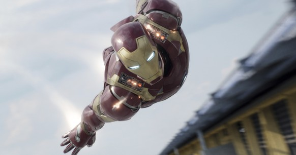 In this image released by Disney, Iron Man, portrayed by Robert Downey Jr., appears in a scene from