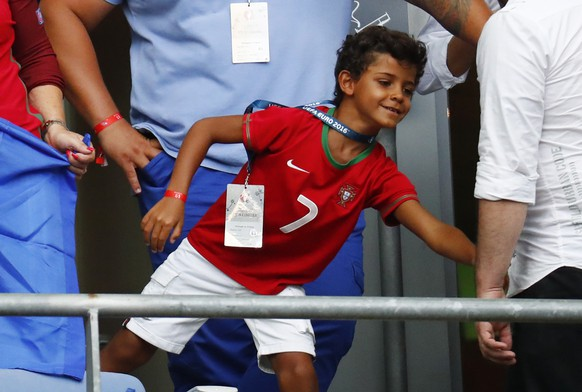 Football Soccer - Portugal v France - EURO 2016 - Final - Stade de France, Saint-Denis near Paris, France - 10/7/16 Son of Portugal's Cristiano Ronaldo, Cristiano Jr in the stands with other family members before the game REUTERS/Kai Pfaffenbach Livepic