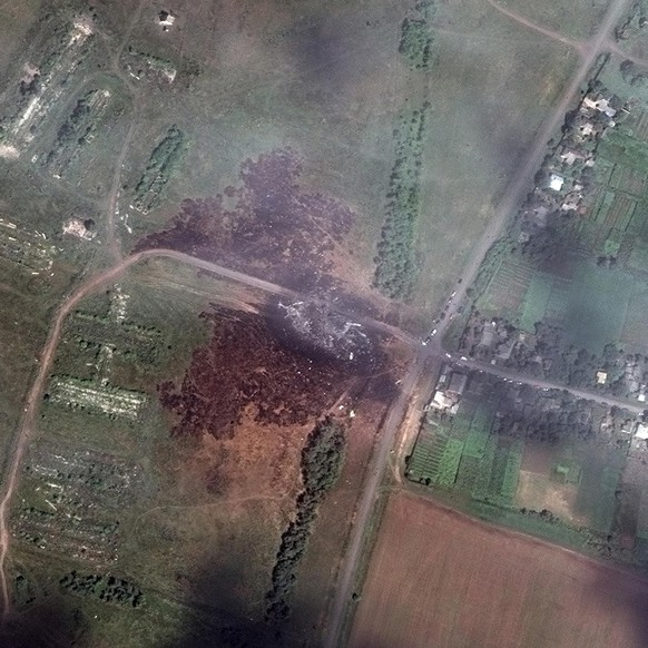 A satellite image shows the crash site of Malaysia Airlines flight MH17 in Ukraine, in this July 20, 2014 DigitalGlobe handout photo. World leaders demanded an international investigation into the shooting down of Malaysia Airlines Flight MH17 with 298 people on board over eastern Ukraine in a tragedy that could mark a pivotal moment in the worst crisis between Russia and the West since the Cold War.   REUTERS/DigitalGlobe/Handout via Reuters (UKRAINE - Tags: DISASTER TRANSPORT TPX IMAGES OF THE DAY) ATTENTION EDITORS - THIS PICTURE WAS PROVIDED BY A THIRD PARTY. REUTERS IS UNABLE TO INDEPENDENTLY VERIFY THE AUTHENTICITY, CONTENT, LOCATION OR DATE OF THIS IMAGE. THIS PICTURE IS DISTRIBUTED EXACTLY AS RECEIVED BY REUTERS, AS A SERVICE TO CLIENTS. NO SALES. NO ARCHIVES. FOR EDITORIAL USE ONLY. NOT FOR SALE FOR MARKETING OR ADVERTISING CAMPAIGNS. MANDATORY CREDIT