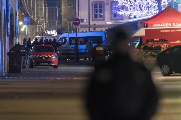 Emergency services arrive at the center of the city of Strasbourg which is close following a shooting, eastern France, Tuesday Dec. 11, 2018. A shooting in the French city of Strasbourg killed at least two people and wounded more than others, officials said, sparking a broad lockdown and major security operation around a world-famous Christmas market. Authorities said the shooter remains at large. (AP Photo/Jean-Francois Badias)