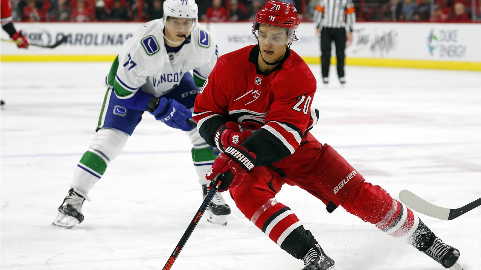 FILE - In this Oct. 9, 2018, file photo, Carolina Hurricanes' Sebastian Aho (20) gathers in the puck in front of Vancouver Canucks' Nikolay Goldobin (77) during the second period of an NHL hockey game in Raleigh, N.C. The Montreal Canadiens have tendered an offer sheet to Carolina Hurricanes restricted free agent forward Sebastian Aho..The offer sheet is worth $42.27 million over five years, an annual salary cap hit of $8.54 million. If Carolina does not match it, the Canadiens must send a first-, second- and third-round pick to the Hurricanes. It's the first offer sheet in the NHL since 2013. (AP Photo/Karl B DeBlaker, File)