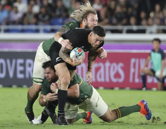 New Zealand's Sonny Bill Williams, center, is tackled during their match against South Africa at the Rugby World Cup Pool B game in Yokohama, Japan, Saturday, Sept. 21, 2019. (AP Photo/Koji Sasahara)