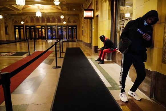 Bright Ekeigwe, of Atlanta, left, and Kenny Smith, right, wait in line before the polls open to vote on Election Day in Atlanta on Tuesday, Nov. 3, 2020. (AP Photo/Brynn Anderson) Kenny Smith,Bright Ekeigwe