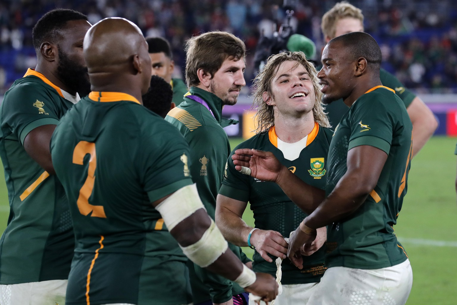 South Africa players celebrate after the Rugby World Cup semifinal at International Yokohama Stadium between Wales and South Africa in Yokohama, Japan, Sunday, Oct. 27, 2019. South Africa won 19-16. (AP Photo/Christophe Ena)