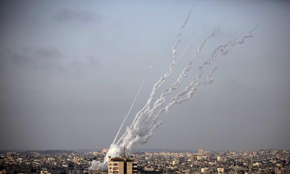 Rockets are launched from the Gaza Strip toward Israel, Monday, May. 10, 2021. (AP Photo/Khalil Hamra)
