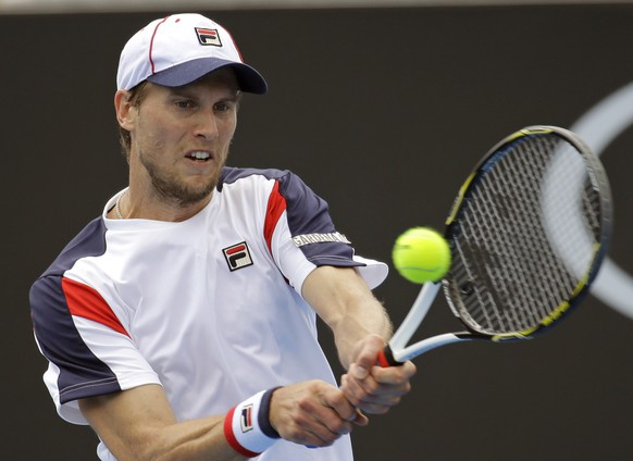 Italy's Andreas Seppi makes a backhand return to Belgium's Steve Darcis during their third round match at the Australian Open tennis championships in Melbourne, Australia, Friday, Jan. 20, 2017. (AP Photo/Aaron Favila)